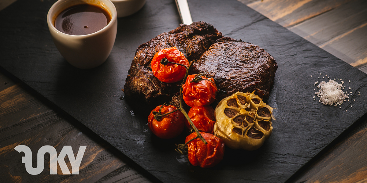 GRILLED ENTRECOTE WITH ROAST GARLIC, CHERRY TOMATOES & BERNAISE SAUCE